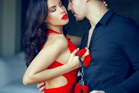 Erotic Milf Woman In Red Dress, Lips, Holding Handcuffs, Seducing Young Lover, Holding Handcuffs, Bd
