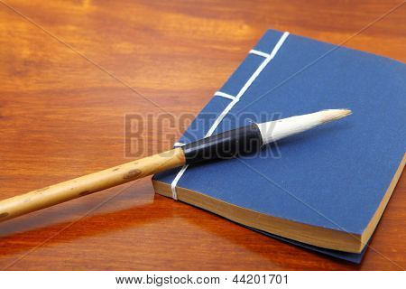 chinese book and writing brush