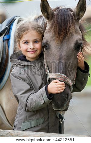 Horse and lovely girl equestrian