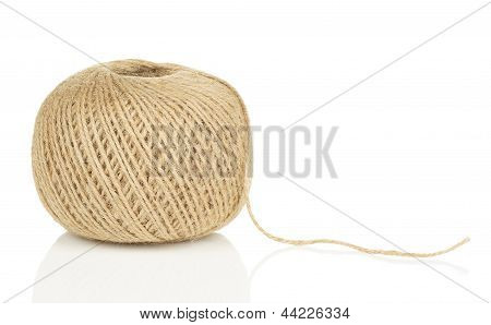 Ball Of Natural String With Loose End on White Background