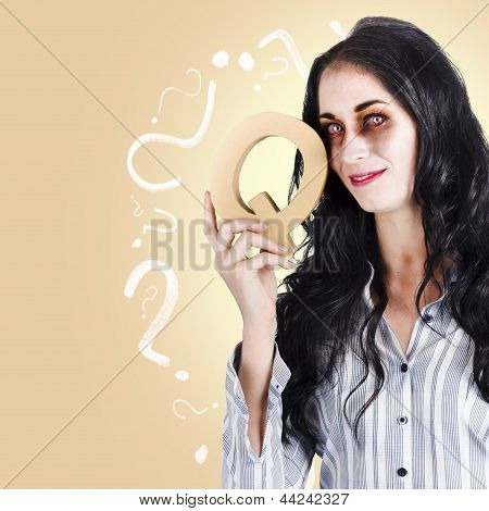 Possessed Businesswoman Holding A Q For Question