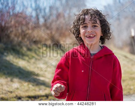 Hispanic Child Walking In A Park At The End Of The Winter