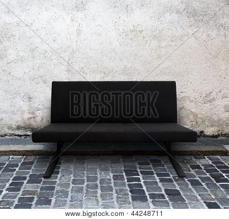 modern sofa on cobblestone street