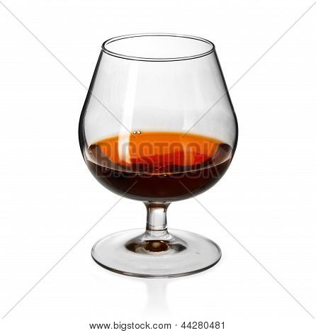 Glass of cognac on on white background