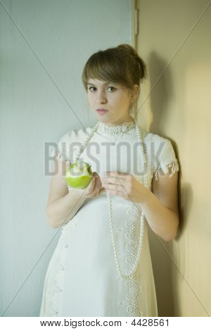 Portrait Of Young Attractive Woman With Apple
