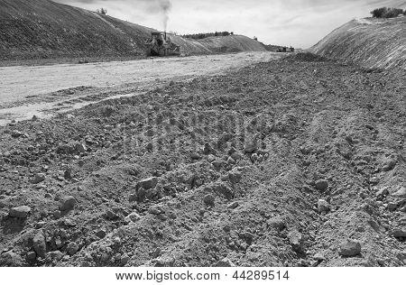 Excavator Unloading Sand