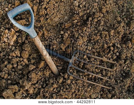 Broken Old Garden Fork On Rocky, Clay Soil - Gardening Background