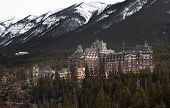Banff Fairmont Hotel and Rimrock Hotel are situated on the slopes of the Rockies in Canada. poster