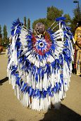 native american costume on display during a parade. poster