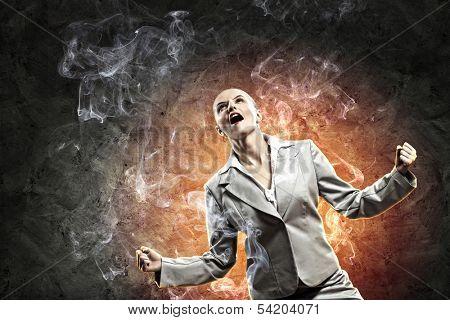 businesswoman in anger screaming against dark grey background
