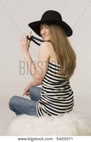Young Girl Blonde With The Long Direct Hairs Of