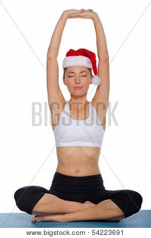 Asian Meditating In A Cap Of Santa Claus