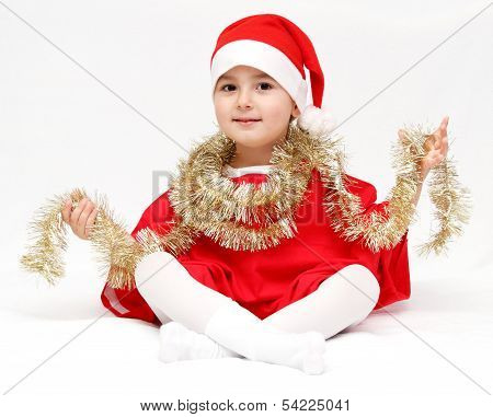 Happy Child In Santa Claus Hat