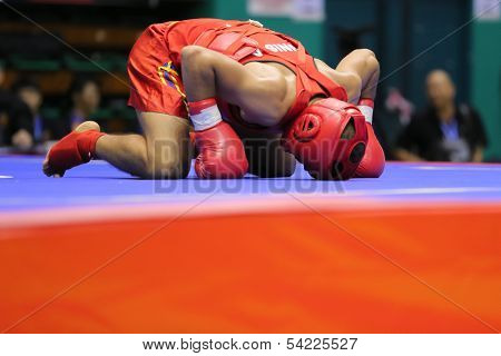 KUALA LUMPUR - NOV 03: Tunisia's Achraf Hadad bows after winning his bout in the 'Sanda' event of the 12th World Wushu Championship on November 03, 2013 in Kuala Lumpur, Malaysia.