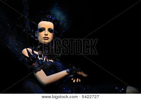 High fashion model in blue dress and fantasy setting