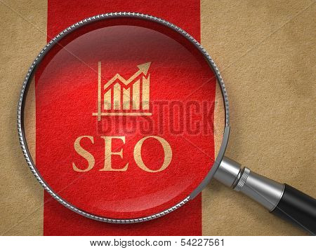 SEO through Magnifying Glass. Internet Concept.