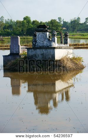 Ancient Grave Reflect On Surface Water