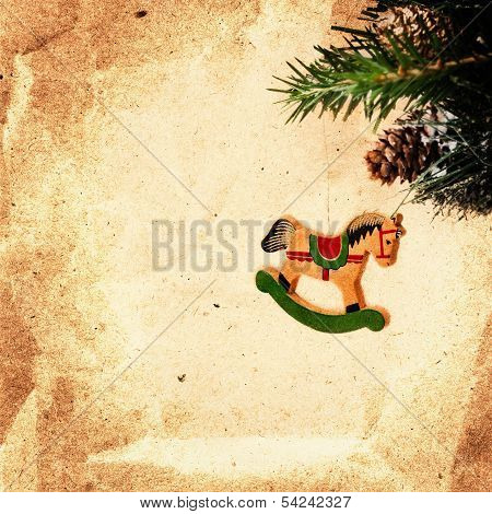 Vintage Christmas Card With Pine Branch And Wooden Decoration On Old Recycled Brown Paper  With  Spa