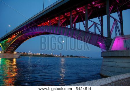 LED lights on the International Peace Bridge frame the Buffalo,NY skyline. poster