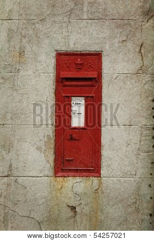 Royal mail box on a old wall.  Vintage style.