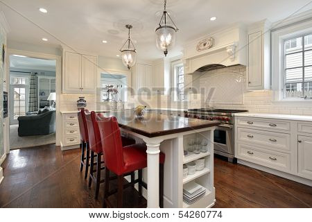 Kitchen in luxury home with wood counter island