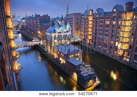 Image of Hamburg- Speicherstadt during twilight blue hour. poster