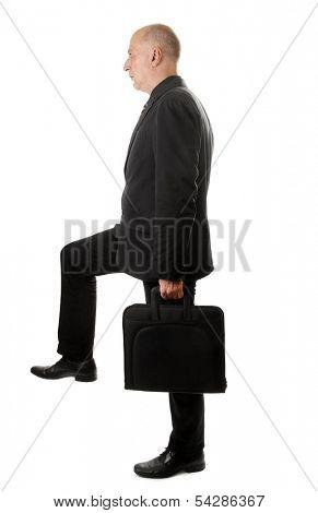 Man with briefcase strides