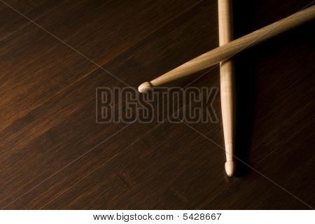 Wood Drumsticks On Bamboo Floor
