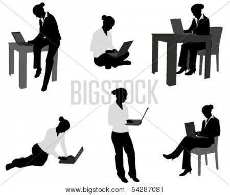 woman working on her notebook silhouettes