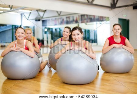 fitness, sport, training, gym and lifestyle concept - group of smiling people working out in pilates class