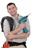 Electrician with drill and cable poster