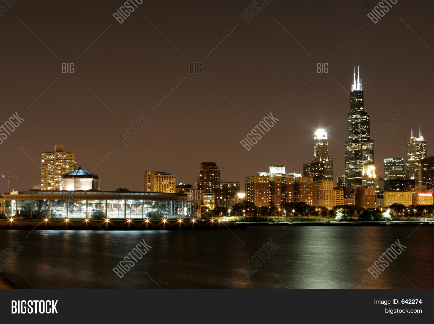 Download Cityscape At Lakeshore Background