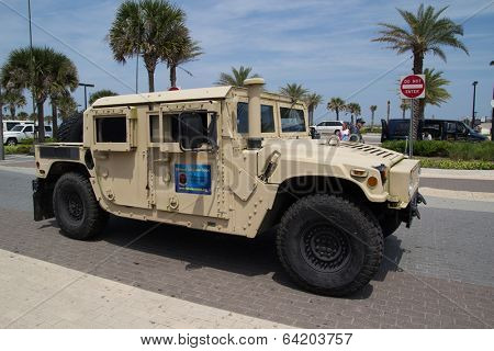 JACKSONVILLE BEACH, FL - APRIL 27, 2014: A Military Humvee at the 68th annual Opening of the Beaches Parade. Each year the parade officially opens the beaches for the summer months.