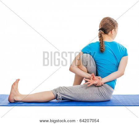 Yoga - young beautiful slender woman yoga instructor doing Forward Bends Sage Twist C pose (Marichyasana C) asana exercise isolated on white background
