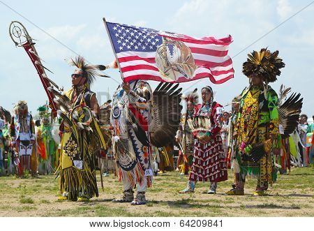 The Eagle Staff leads the Grand Entry at he NYC Pow Wow in Brooklyn