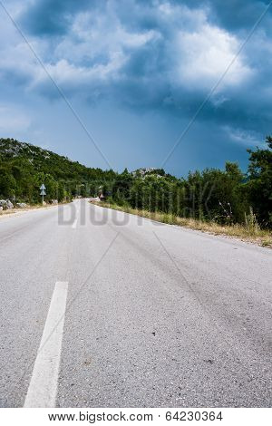 Lonely Road In The Countryside And Cloudy Weather