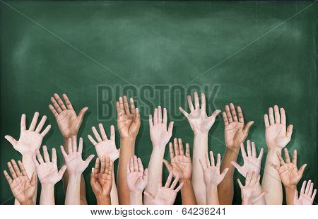 Multiethnic Group of Hands Raised with Blackboard