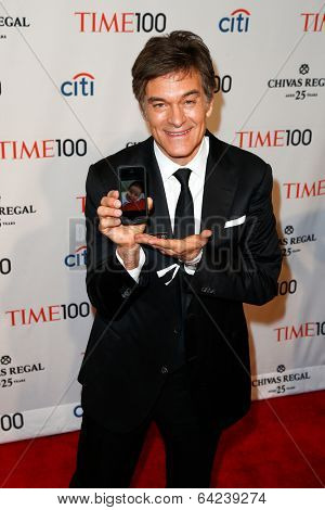 NEW YORK-APR 29: Dr. Mehmet Oz holds a photo of his granddaughter Filomena at the Time 100 Gala for the Most Influential People at Frederick P. Rose Hall on April 29, 2014 in New York City.