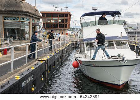 Boat Tying Up In Seattle Ballard Locks