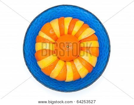 oranges and lemons in glass bowl on a white background
