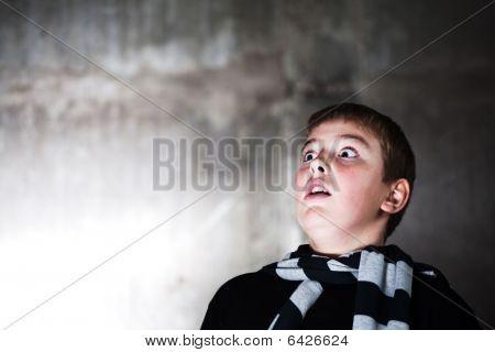 Scarry Teenaiger Looking Up At Something Big