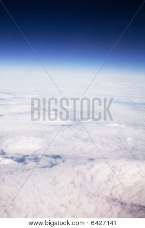 Aerial view of cloud formation and sky taken from high altitude poster