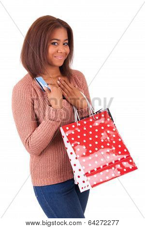 Beautiful African Woman Smiling Holding A Credit Card And Shopping Bags