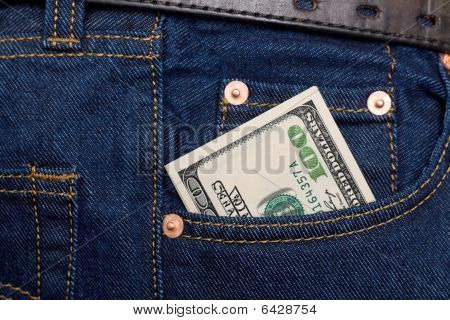 Hundred Dollars Banknotes In Rocket Of Blue Jeans