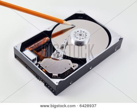 Open Hard Drive With Angled Pencil Point On Platter