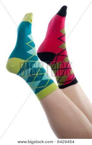 Vertical Image Brightly Colored Socks  On A White Background