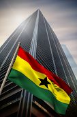 Ghana national flag against low angle view of skyscraper poster