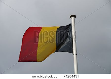 Belgian national flag blowing in the wind