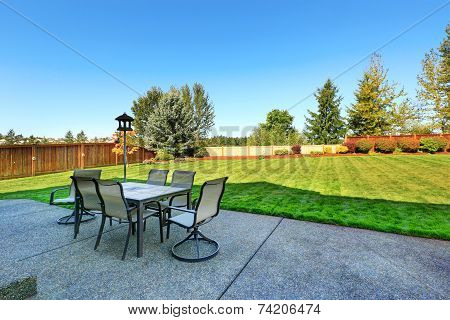 Patio Area Overlooking Backyard Landscape