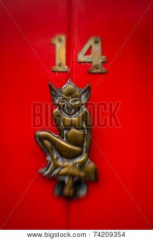 Bronze door figure